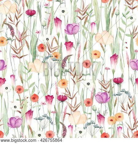 Cute seamless pattern with different wild flowers. Watercolor background for fabric, textile, nursery wallpaper. Meadow with wild flowers.