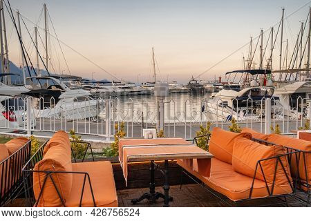 Cozy outdoor cafe in the harbour of Kemer resort town in Antalya province, Mediterranean sea, Turkey. Cozy outdoor restaurant at twilight in Kemer.