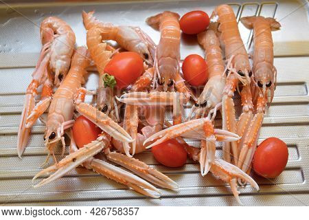 Raw Langoustines Or Scampi With Fresh Cherries Tomatoes