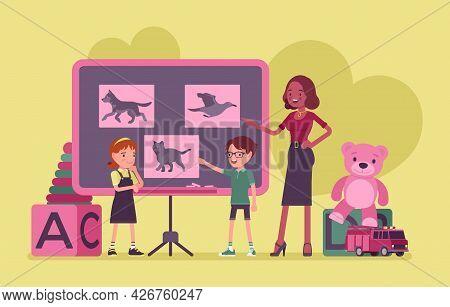 Kindergarten Lesson, Female Black Teacher, Children At Blackboard Studying Animals. Preschool Classr