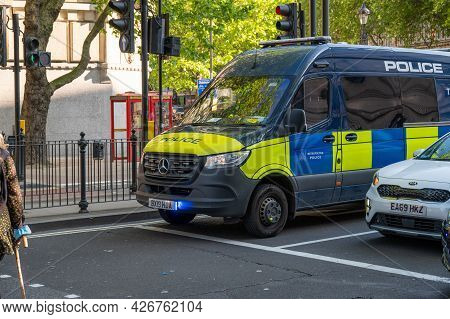 London - May 29, 2021: Police Van With Blue Flashing Lights On A London Street