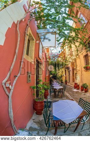 Rethymno, Crete Island, Greece - June 19, 2021: View With Small And Picturesque Street Terraces Loca