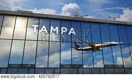 Airplane Landing At Tampa Florida, Usa Airport Mirrored In Terminal