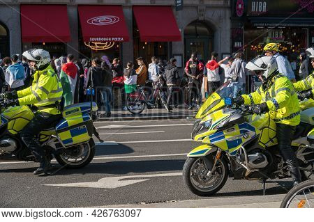 London - May 29, 2021: British Police Motorcyclists At A Freedom For Palestine Protest Rally In Lond