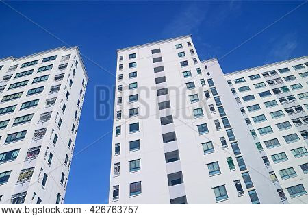 Low Angle View Of Modern Buildings Against Vivid Blue Sunny Sky