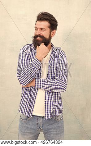 Happy Man With Bearded Smile On Unshaven Face And Stylish Hair In Casual Fashion Style, Salon