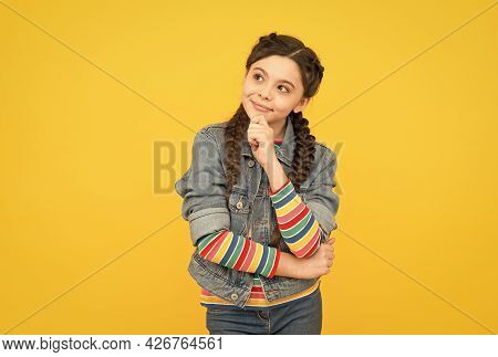 Dreamy Little Girl With Braids Wear Denim Clothes, Making Wish Concept