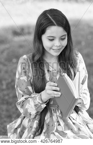 Child Girl Relaxing Outdoors With Book, New Chapter Concept