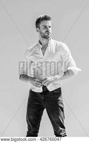 Hot Day Outdoors. Heat Season. Formal Fashion. Formal Style. Attractive Man Taking Off Shirt. Confid