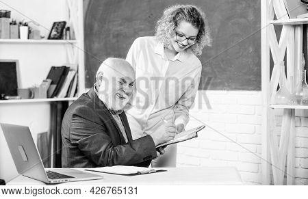 Student Asking Teacher About Task. Solving Math Tasks. School Education Concept. Check Homework. Edu