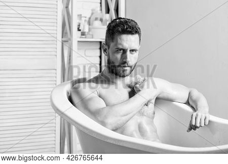 Wash Off Foam With Water Carefully. Macho Attractive Nude Guy. Sexy Man In Bathroom. Sex And Relaxat
