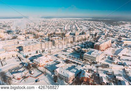 Dobrush, Gomel Region, Belarus. Aerial View Of Skyline Cityscape In Sunny Winter Day. Snowy Landscap
