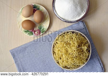 Cooking Homemade Noodles, Flat Lay. Raw Pasta. On Wooden Surface Ingredients Are Wheat Flour And Egg