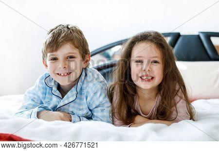 Two Happy Kids In Pajamas Celebrating Pajama Party. Preschool And School Boy And Girl Having Fun Tog