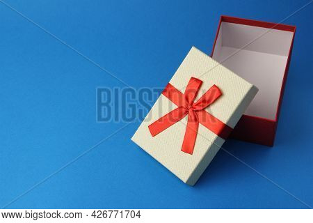 Empty Open Red Gift Box With Red Ribbon Bow On Blue Background, Present Or Surprise After Party, Moc