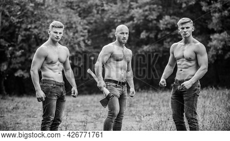 Group Muscular Men With Axe. Athletic Man Use Ax. Wild Masculinity. Brotherhood Concept. Strength An