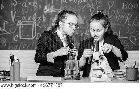 Biology Lab. Happy Genius. Little Girls Scientist With Microscope. Little Girls Genius In School Lab