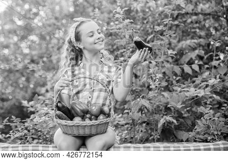 Kid Hold Basket With Vegetables Nature Background. Eco Farming. Girl Cute Smiling Child Living Healt