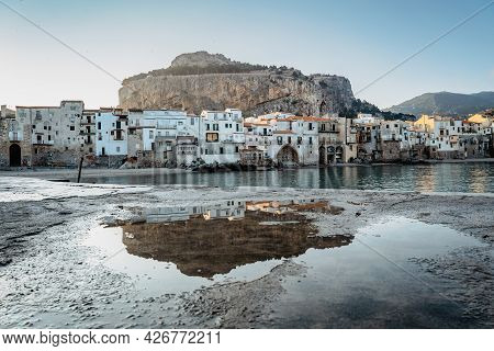Sunrise On Beach In Cefalu, Sicily, Italy, Old Town Panoramic View With Colorful Waterfront Houses,