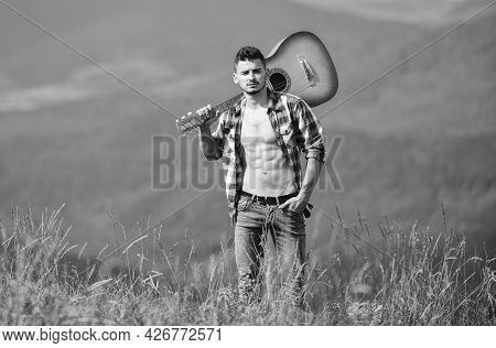 Man With Guitar Walking On Top Of Mountain. Best Way To Escape From City. Guy Hiker Enjoy Pure Natur