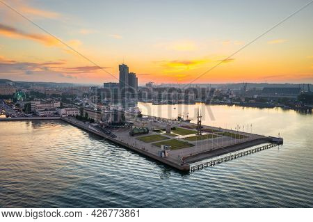 Gdynia, Poland - July 4, 2021:  Sails monument on Baltic Sea square at sunset, Gdynia. This metal artistic shaped monument is a symbol of the sea and connection of Gdynia with shipyard in Poland.