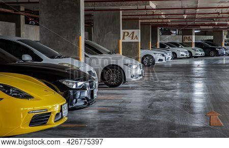 Bangkok, Thailand - 30 Jun 2021 : Row Of Different Cars Parked In Residential Apartment Building At