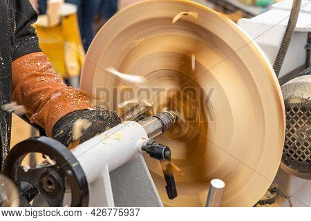 Mechanical Woodworking On A Lathe. Carpentry Work In The Workshop. Woodworking Concept