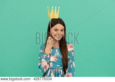 Prom Party. Happy Girl Hold Paper Crown. Prom Queen Blue Background. Contest Winner. Enjoying Photob