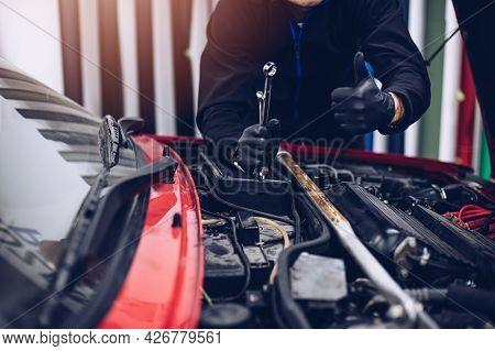Car Mechanic Showing Thumb Up Ok Gesture