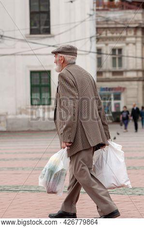 Timisoara, Romania - May 07, 2015: Man Walking On The Street. Real People.