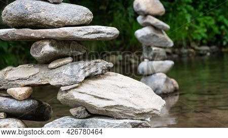Rough Stone Cairns Standing Proudly In The Shallow Creek Water