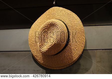 A Large Straw Hat Lies On A Shop Window