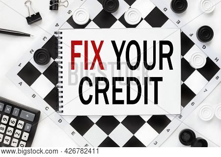 Fix Your Credit. Text Is Written On A Notepad On A Chessboard