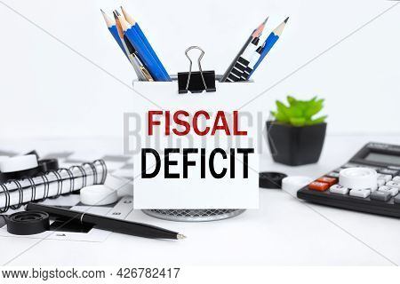 Fiscal Deficit. Text Attached To Pencil Case With Crayons On White Background
