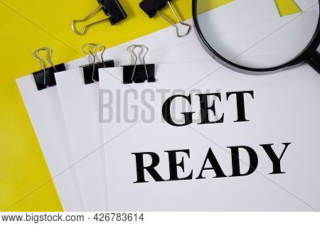 Get Ready Concept Word Written On White Paper And Yellow Background With Magnifier