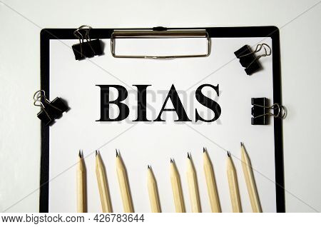 Bias The Word Is Written On A White Piece Of Paper With Pencils