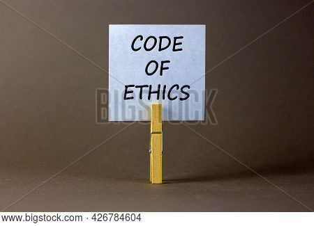 Code Of Ethics Symbol. White Paper With Words 'code Of Ethics', Clip On Wood Clothespin. Beautiful G