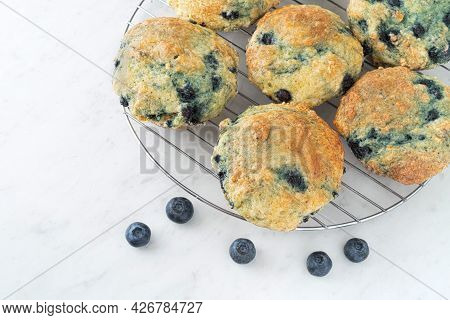 Homemade Blueberry Muffins On A Cooling Rack.