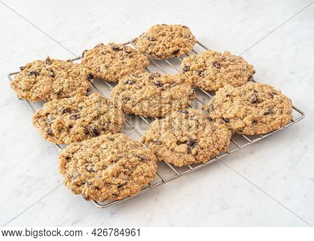 Tasty Homemade Raisin Oatmeal Cookies On A White Marble Countertop.