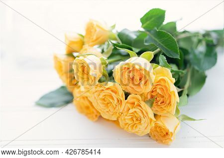 Bouquet Of Little Yellow Roses In A Studio Setting.