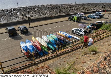 Old Hunstanton, Norfolk, England - June 13, 2021. Canoes Tidy And Upside Down On An Iron Platform.