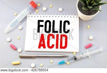 Folic Acid. Medicine Concept Yellow Paper Sticker With Inscription Folic Acid And Stethoscope, Medic