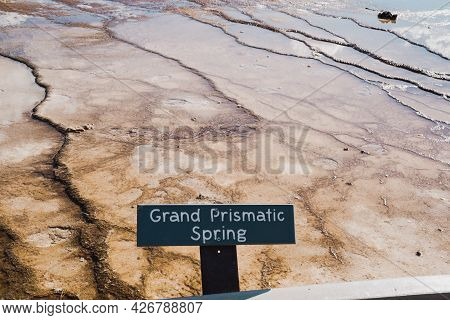 Sign For The Grand Prismatic Spring Hot Springs In Yellowstone National Park In The Midway Geyser Ba