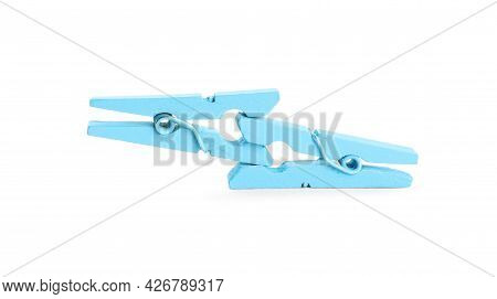 Two Light Blue Wooden Clothespins On White Background