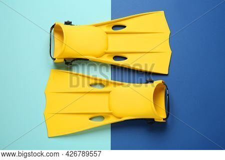 Pair Of Yellow Flippers On Color Background, Flat Lay