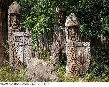 Wooden Figures Of Warriors Of The Piast Dynasty, Marking The Entrance To Bedkowice Archeological Mus
