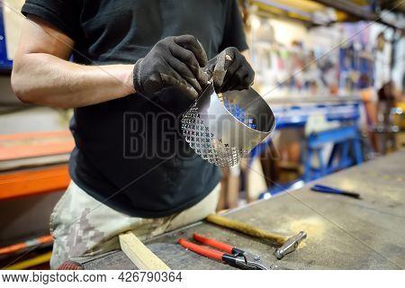 Metalwork Craftsman Making Handmade Lamp At Workshop. Man Worker Screws Up The Parts Of Lampshade. D