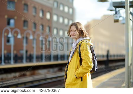 Beautiful Young Woman Is Waiting For A Train On A Platform In The New York Subway. Transport Of Nyc,