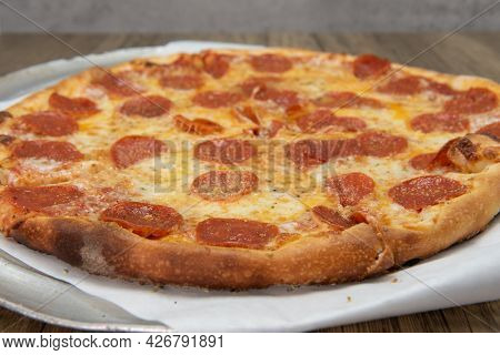 Pepperoni Pizza With Crispy Crust And Melted Cheese For A Perfect Lunch Date.
