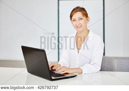 Teleworking At Home For 42 Year Old White Female Accountant.